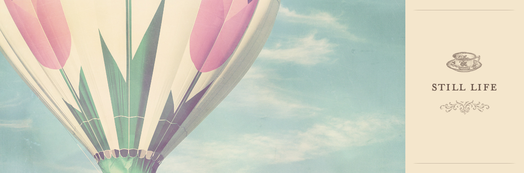 still life photography of an air balloon with petals in pastel